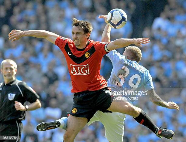 Manchester United's English defender Gary Neville vies with Manchester City's Welsh forward Craig Bellamy during the English Premier League football...
