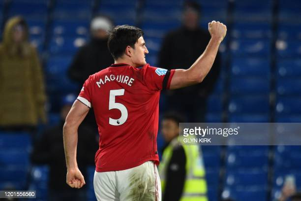 Manchester United's English defender Harry Maguire celebrates on the pitch after the English Premier League football match between Chelsea and...