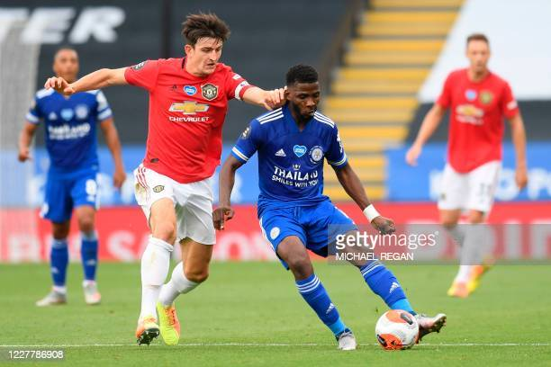 Manchester United's English defender Harry Maguire defends against Leicester City's Nigerian striker Kelechi Iheanacho during the English Premier...