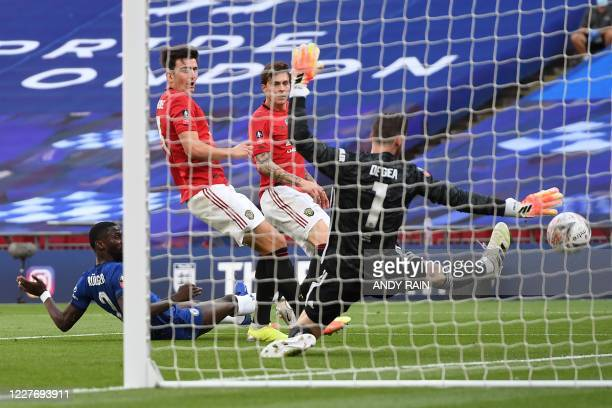 Manchester United's English defender Harry Maguire deflects the ball past Manchester United's Spanish goalkeeper David de Gea into his own net for...