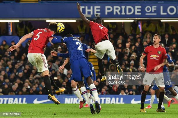 Manchester United's English defender Harry Maguire heads home their second goal during the English Premier League football match between Chelsea and...