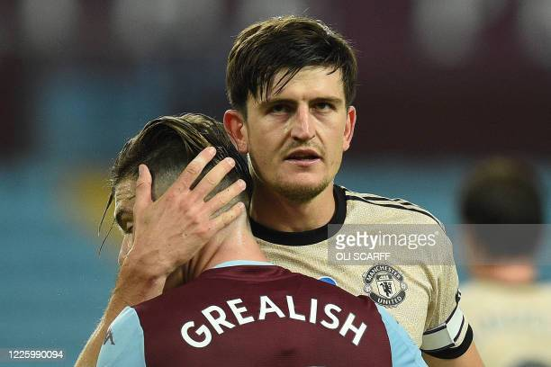 Manchester United's English defender Harry Maguire hugs Aston Villa's English midfielder Jack Grealish after the English Premier League football...