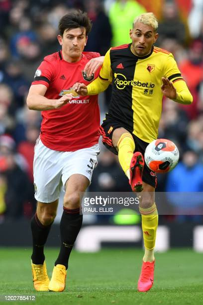 Manchester United's English defender Harry Maguire tangles with Watford's Argentinian midfielder Roberto Pereyra during the English Premier League...