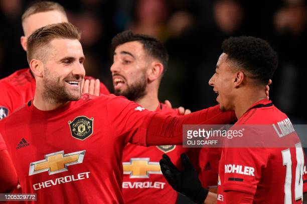 Manchester United's English defender Luke Shaw celebrates scoring his team's first goal with Manchester United's English midfielder Jesse Lingard...