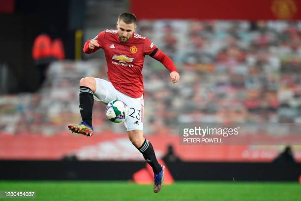 Manchester United's English defender Luke Shaw controls the ball during the English League Cup semi final first leg football match between Manchester...
