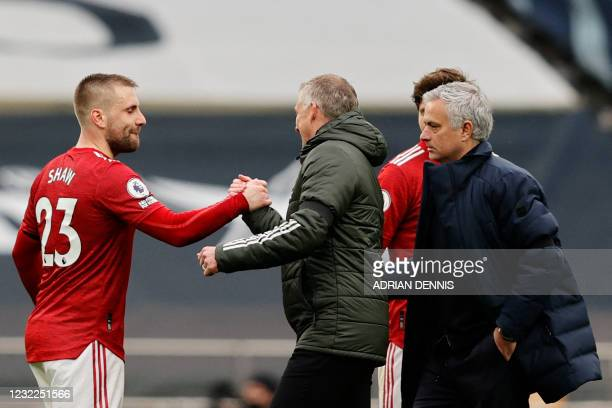 Manchester United's English defender Luke Shaw is congratulated by Manchester United's Norwegian manager Ole Gunnar Solskjaer as Tottenham Hotspur's...