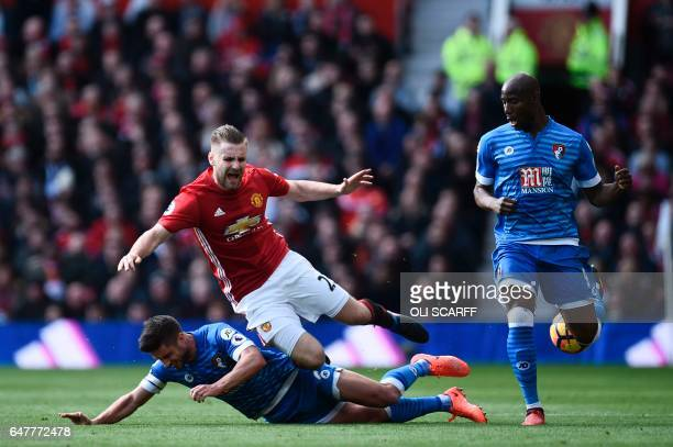 Manchester United's English defender Luke Shaw is tackled by Bournemouth's South Africanborn English midfielder Andrew Surman during the English...