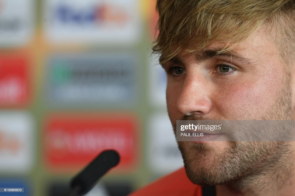 Manchester United's English defender Luke Shaw takes part in a press conference at their Carrington base in Manchester, northwest England, on October 19, 2016 ahead of their UEFA Europa League group A football match against Fenerbahce on October 20. / AFP / PAUL