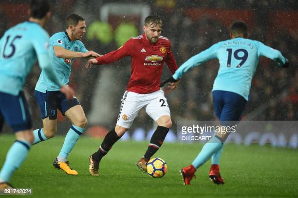Manchester United's English defender Luke Shaw vies with Bournemouth's English midfielder Junior Stanislas during the English Premier League football...