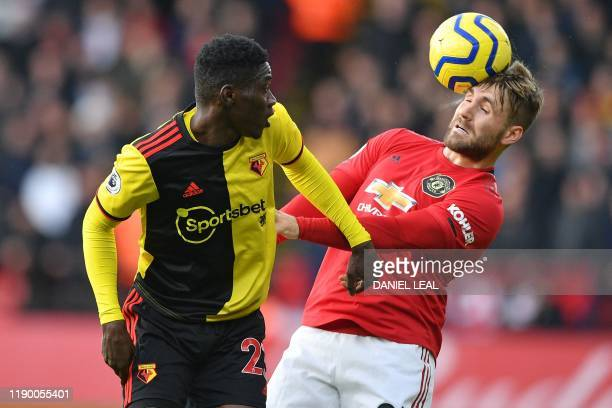 TOPSHOT Manchester United's English defender Luke Shaw vies with Watford's Senegalese midfielder Ismaila Sarr during the English Premier League...