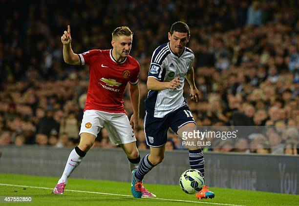 Manchester United's English defender Luke Shaw vies with West Bromwich Albion's Scottish midfielder Graham Dorrans during the English Premier League...