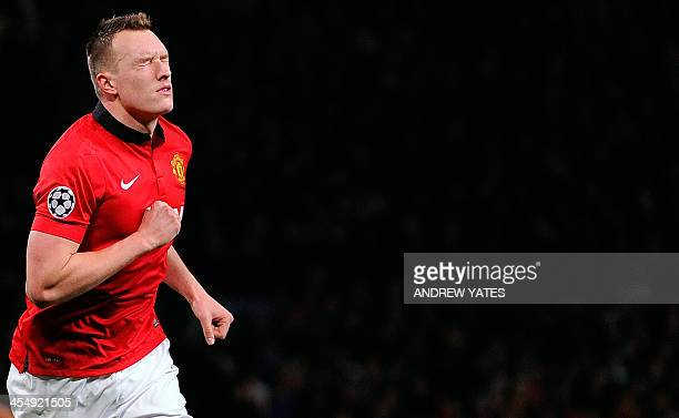 Manchester United's English defender Phil Jones celebrates scoring a goal during the UEFA Champions League football match between Manchester United...