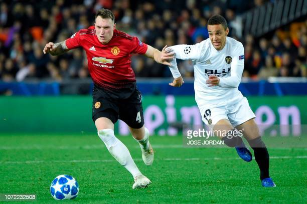 Manchester United's English defender Phil Jones challenges Valencia's Spanish forward Rodrigo Moreno during the UEFA Champions League group H...