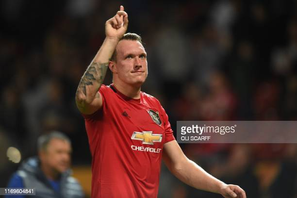 Manchester United's English defender Phil Jones gestures to supporters as he leaves the pitch after the UEFA Europa League Group L football match...