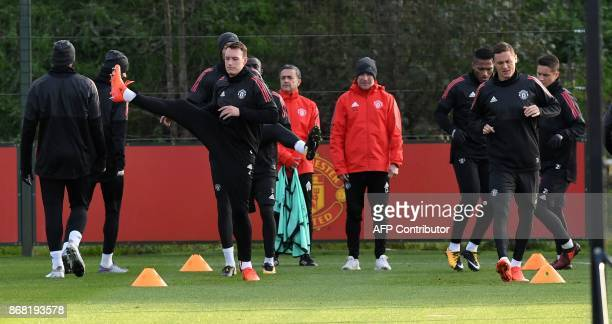 Manchester United's English defender Phil Jones Manchester United's Serbian midfielder Nemanja Matic and 21 attend a team training session at the...