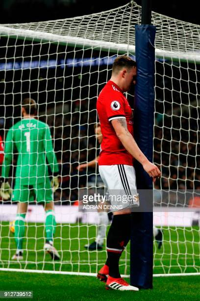 Manchester United's English defender Phil Jones reacts after scoring an own goal for Tottenham's second goal during the English Premier League...
