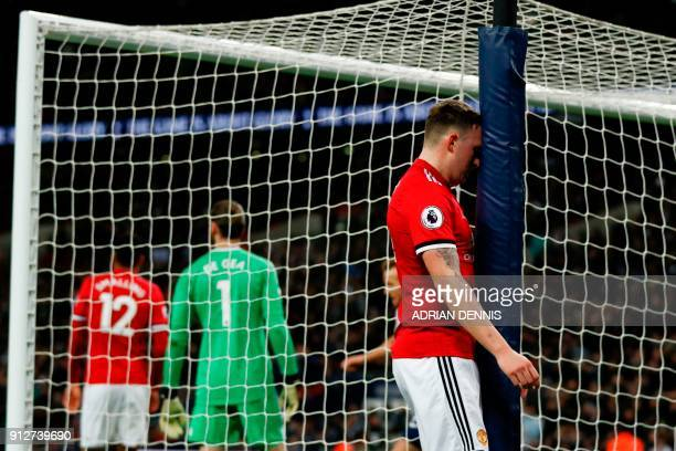 TOPSHOT Manchester United's English defender Phil Jones reacts after scoring an own goal for Tottenham's second goal during the English Premier...