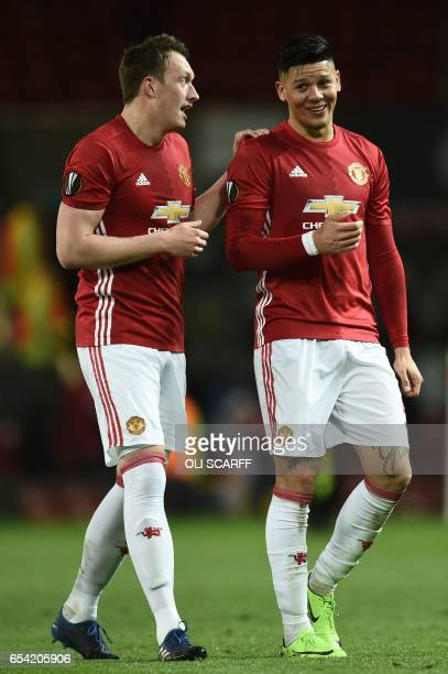 Manchester United's English defender Phil Jones talks with Manchester United's Argentinian defender Marcos Rojo at the end of the UEFA Europa League...
