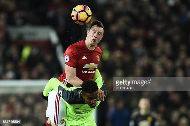 Manchester United's English defender Phil Jones vies with Liverpool's Belgian striker Divock Origi during the English Premier League football match...