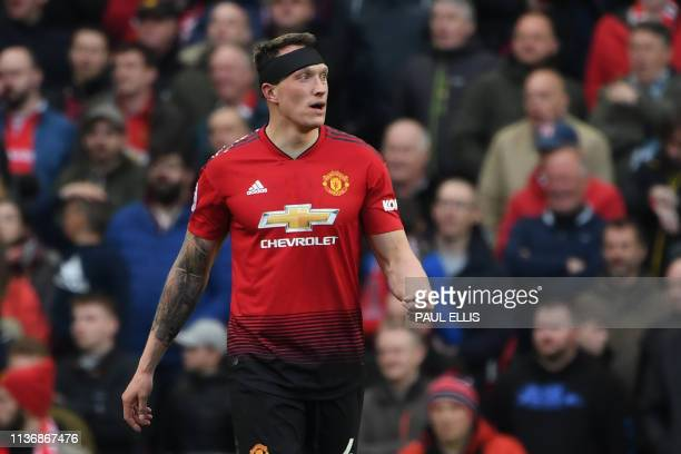 Manchester United's English defender Phil Jones walks back after receiving medical attention during the English Premier League football match between...