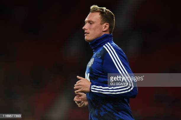 Manchester United's English defender Phil Jones warms up ahead of the UEFA Europa League Group L football match between Manchester United and Astana...