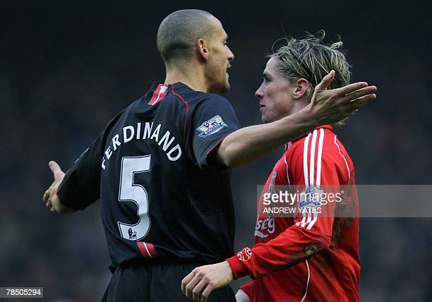 Manchester United's English defender Rio Ferdinand faces up to Liverpool's Spanish forward Fernando Torres during their English Premiership football...