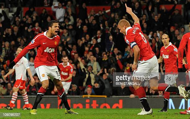 Manchester United's English defender Wes Brown celebrates with Brazilian striker Bebe after scoring the opening goal of the FA Cup fifth round...