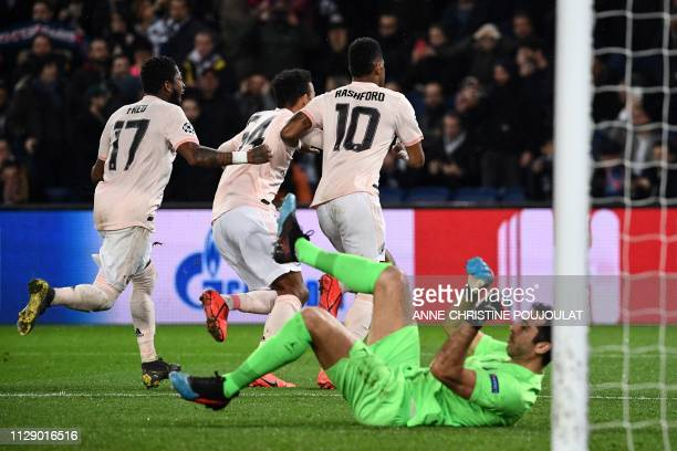 Manchester United's English forward Marcus Rashford celebrates after scoring a penalty past Paris SaintGermain's Italian goalkeeper Gianluigi Buffon...