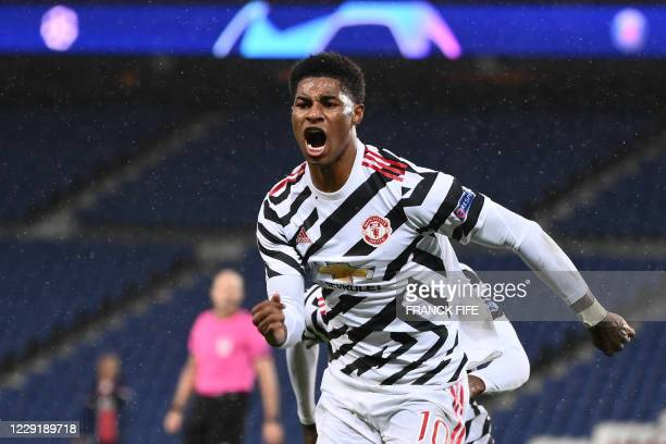 Manchester United's English Forward Marcus Rashford celebrates after scoring a goal during the UEFA Europa League Group H first-leg football match...