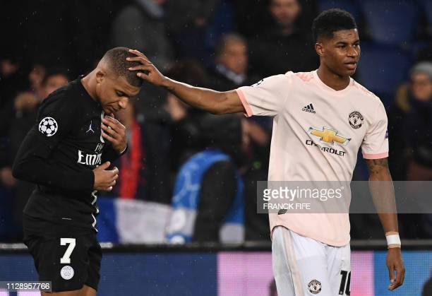 Manchester United's English forward Marcus Rashford cheers up Paris SaintGermain's French forward Kylian Mbappe at the end of the UEFA Champions...