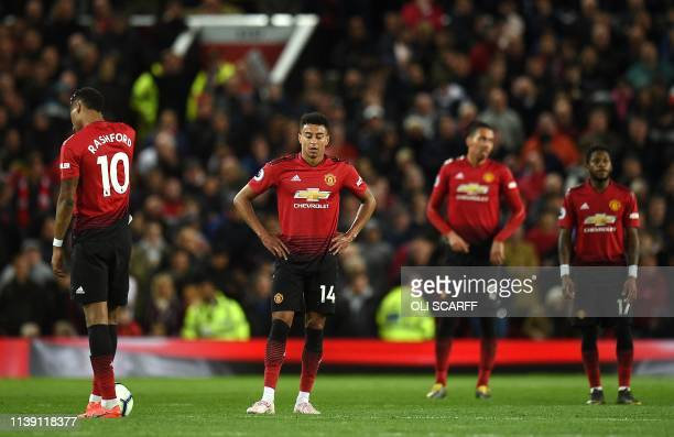 Manchester United's English forward Marcus Rashford Manchester United's English midfielder Jesse Lingard Manchester United's English defender Chris...