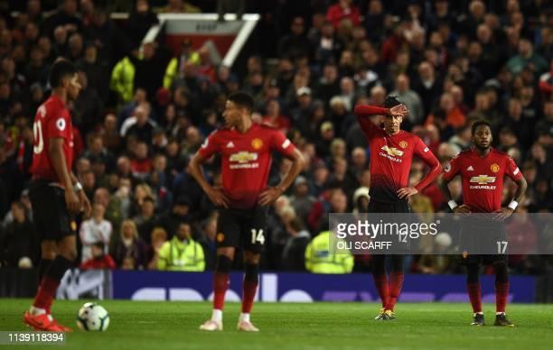Manchester United's English forward Marcus Rashford Manchester United's English midfielder Jesse Lingard Manchester United's English defender Chris...