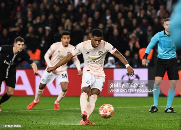 TOPSHOT Manchester United's English forward Marcus Rashford scores a penalty during the UEFA Champions League round of 16 secondleg football match...