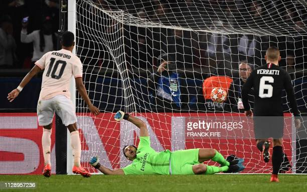 Manchester United's English forward Marcus Rashford scores a penalty during the UEFA Champions League round of 16 secondleg football match between...