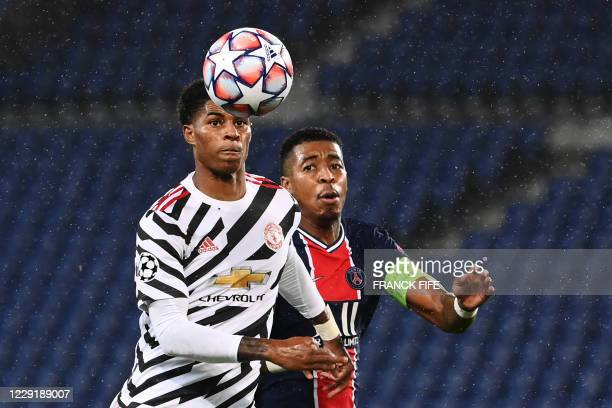 Manchester United's English Forward Marcus Rashford vies for the ball with Paris SaintGermain's French defender Presnel Kimpembe during the UEFA...