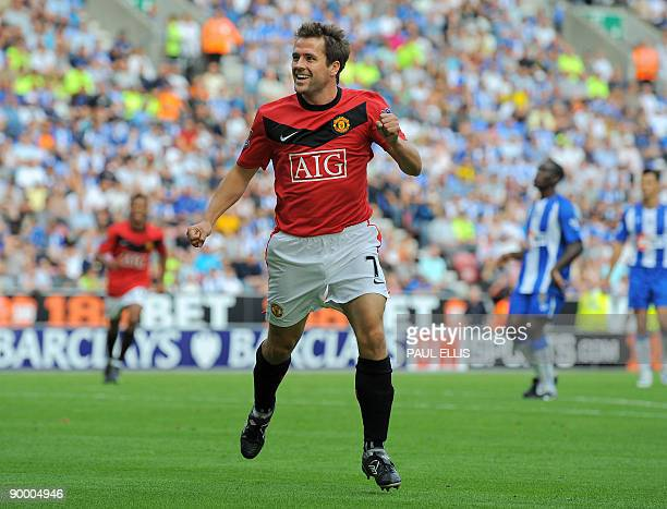 Manchester United's English forward Michael Owen celebrates scoring his first league goal for the club during the English Premier League football...