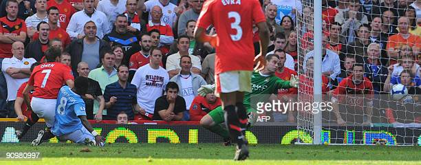 Manchester United's English forward Michael Owen scores the fourth goal during the English Premier League football match against Manchester City at...