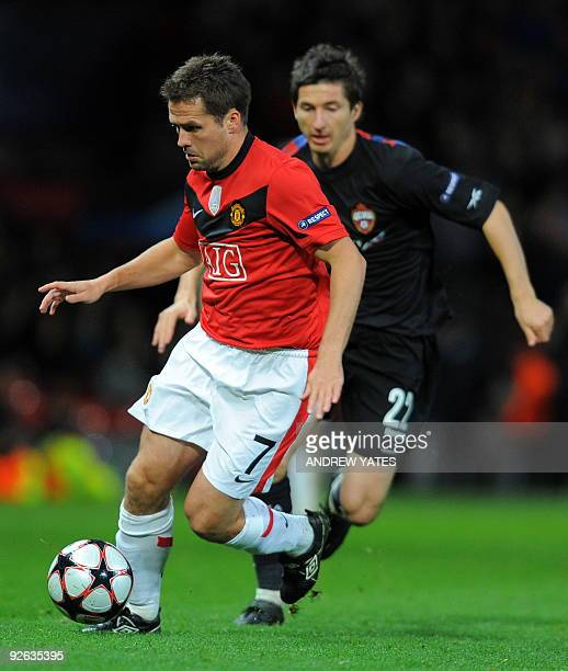 Manchester United's English forward Michael Owen shields the ball from CSKA Moscow's Russian midfielder Evgeni Aldonin during their UEFA Champions...