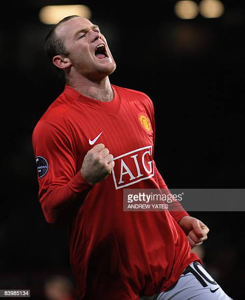 Manchester United's English forward Wayne Rooney celebrates after scoring during their UEFA Champions league group E football match against Aalborg...