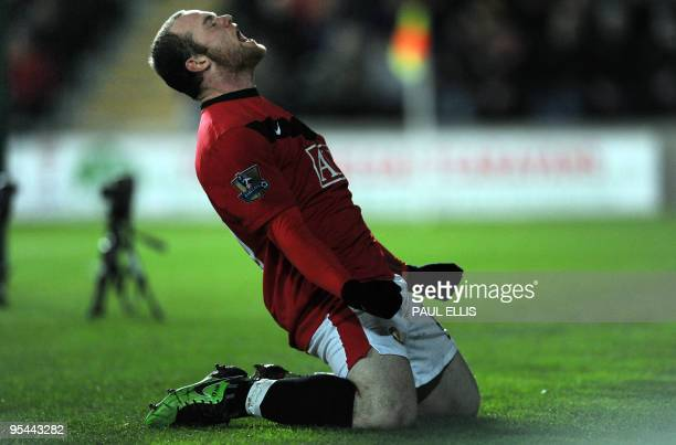 Manchester United's English forward Wayne Rooney celebrates his second goal against Hull City during their English Premier League football match at...