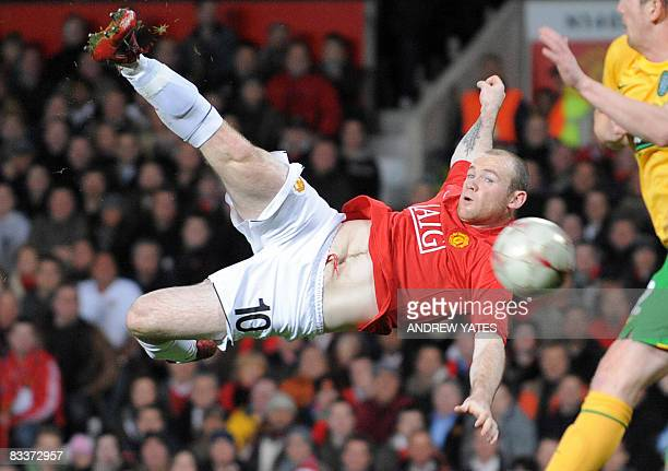Manchester United's English forward Wayne Rooney shoots against Celtic during their UEFA Champions League Group E football match at Old Trafford in...