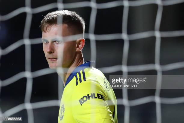 Manchester United's English goalkeeper Dean Henderson looks on during the English League Cup third round football match between Luton Town and...