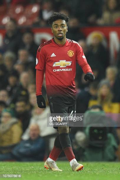 Manchester United's English midfielder Angel Gomes plays during the English Premier League football match between Manchester United and Huddersfield...