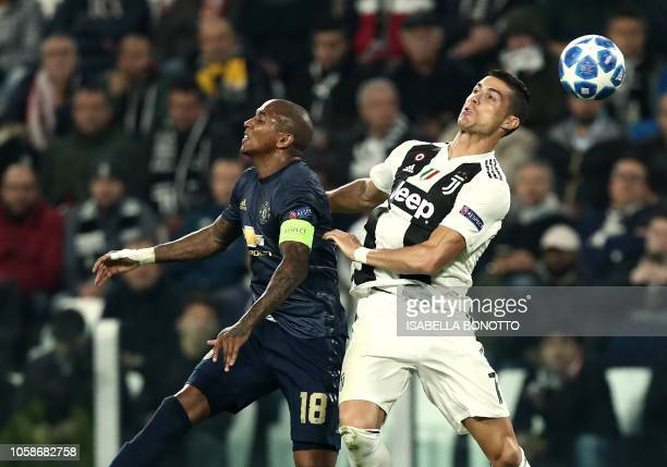 Manchester United's English midfielder Ashley Young and Juventus' Portuguese forward Cristiano Ronaldo go for a header during the UEFA Champions...