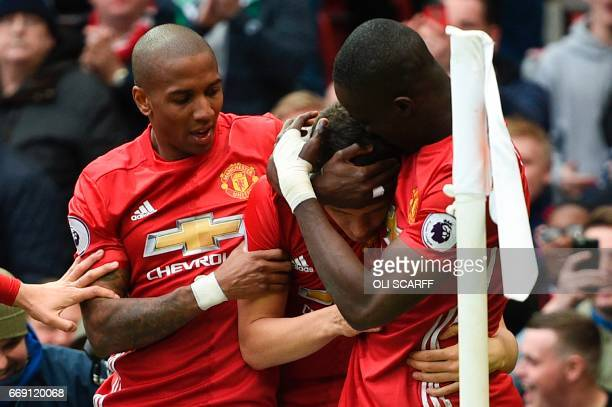 Manchester United's English midfielder Ashley Young and Manchester United's Ivorian defender Eric Bailly congratulate Manchester United's Spanish...