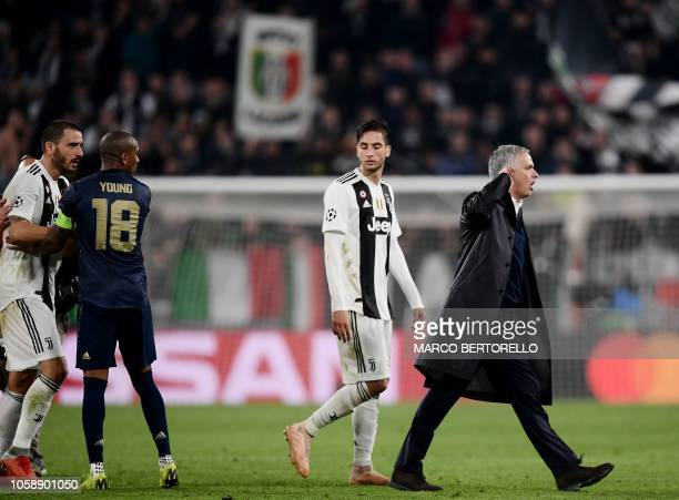 Manchester United's English midfielder Ashley Young holds off Juventus' Italian defender Leonardo Bonucci as Manchester United's Portuguese manager...