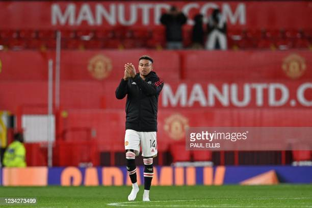 Manchester United's English midfielder Jesse Lingaard reacts at the final whistle during the English Premier League pre-season friendly football...