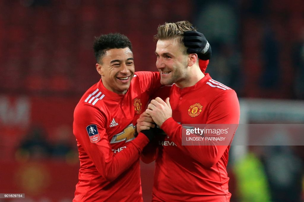 Manchester United's English midfielder Jesse Lingard (L) and Manchester United's English defender Luke Shaw (R) celebrate together after thefinal whistle of the English FA Cup third round football match between Manchester United and Derby County at Old Trafford in Manchester, north west England, on January 5, 2018. / AFP PHOTO / Lindsey PARNABY / RESTRICTED TO EDITORIAL USE. No use with unauthorized audio, video, data, fixture lists, club/league logos or 'live' services. Online in-match use limited to 75 images, no video emulation. No use in betting, games or single club/league/player publications. /