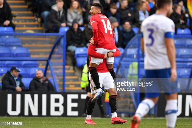 Manchester United's English midfielder Jesse Lingard celebrates after scoring their third goal during the English FA Cup fourth round football match...
