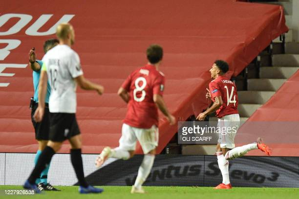 Manchester United's English midfielder Jesse Lingard celebrates after scoring during the UEFA Europa League last 16 second leg football match between...